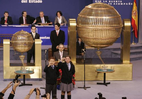 Two schoolchildren call out the winning number during Spain's El Gordo lottery in Madrid