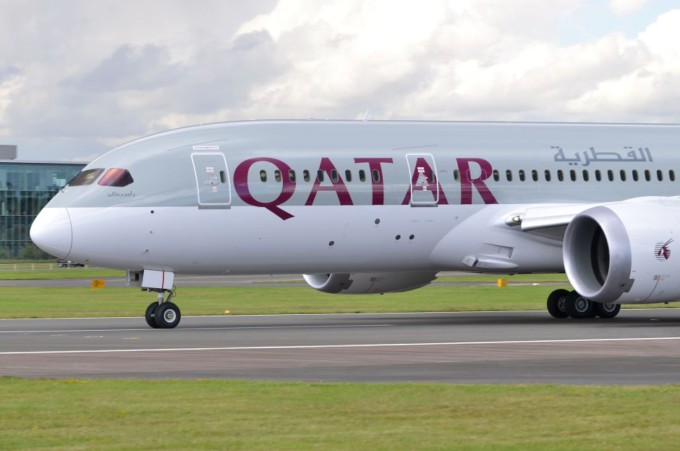 Boeing 787 Dreamliner in the colours of Qatar Airways beginning its take-off run at Farnborough International Airshow 2012